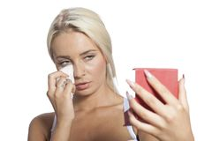 Young woman clean face with wet wipes and holding mirror Royalty Free Stock Photos