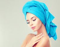 Young woman with clean fresh skin and soft, delicate make up,. Portrait of young woman with clean fresh skin and soft, delicate make up,with towel on her head Royalty Free Stock Image