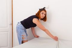 Young woman clean house royalty free stock images