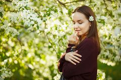 Young woman with clean skin near a blooming apple tree. portrait of girl in spring park. stock image