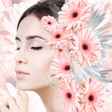 Young woman with clean skin over flowers. Stock Image