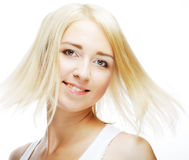 Young woman with clean skin on a white. Face of a sexy beautiful young woman with clean skin on a white background Royalty Free Stock Images