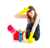 Young woman cleaner tired Stock Image