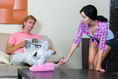 Young woman cleaning the apartment Royalty Free Stock Photo