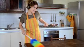 Young woman cleaning and dancing stock footage