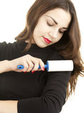 Young woman cleaning dust with lint roller Stock Images