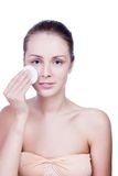 Young woman cleaning face Stock Images
