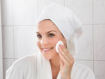 Young Woman Cleaning The Face Royalty Free Stock Photo