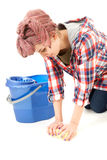 Young woman cleaning floor Stock Photos