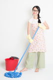 Young Woman Cleaning floor Royalty Free Stock Images