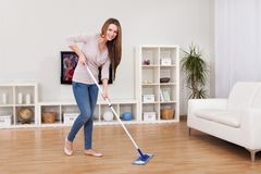 Young woman cleaning floor Stock Image