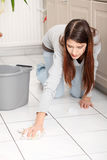 Young woman cleaning flor Stock Photo