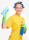 Young woman is cleaning glass using rag Royalty Free Stock Photography