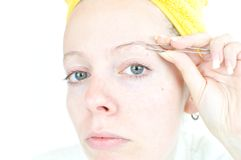 Young woman cleaning her eyebrows Royalty Free Stock Photos