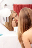 Young woman cleaning her face Stock Photography
