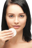 Young woman cleaning her face Royalty Free Stock Photo