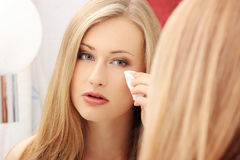 Young woman cleaning her face Stock Photo