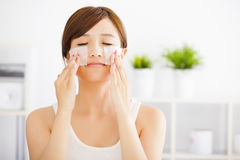 young woman cleaning her face with cotton Stock Photos