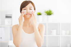 Young woman cleaning her face with cotton Royalty Free Stock Photo