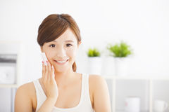 Young woman cleaning her face with cotton Royalty Free Stock Image