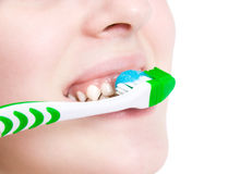 Young woman cleaning her teeth Stock Photos