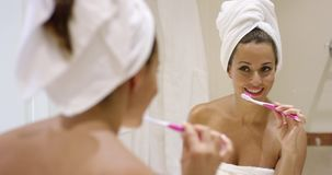 Young woman cleaning her teeth stock footage