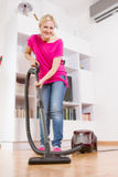 Young Woman Cleaning Home Royalty Free Stock Image