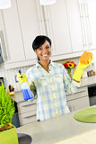 Young woman cleaning kitchen stock photography