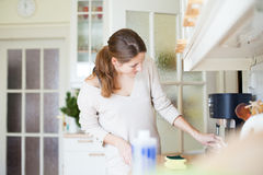 Young woman  cleaning the kitchen Royalty Free Stock Photography