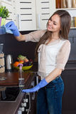 Young woman cleaning kitchen Royalty Free Stock Photos