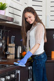 Young woman cleaning kitchen Royalty Free Stock Photography
