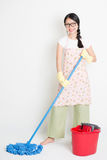 Young Woman Cleaning with mop and bucket Royalty Free Stock Image