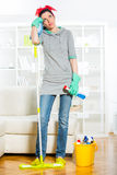 Young woman cleaning and mopping floor at home. Royalty Free Stock Images