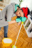 Young woman cleaning and mopping floor at home. Woman cleaning and mopping floor at home Royalty Free Stock Images