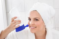 Young Woman Cleaning Nose Stock Photography