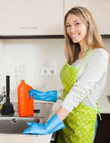 Young woman cleaning pipe with detergent Stock Photos