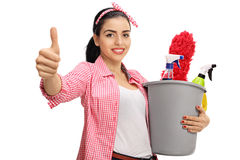 Young woman with cleaning products making a thumb up sign Royalty Free Stock Image