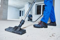 Cleaning service. dust removal with vacuum cleaner. Young woman cleaning and removing construction dust with vacuum cleaner after repair royalty free stock photos