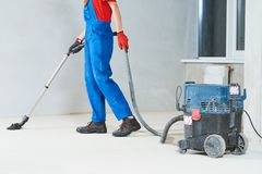 Cleaning service. dust removal with vacuum cleaner royalty free stock images