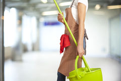 Young woman with cleaning supplies in building Royalty Free Stock Images