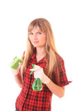 Young woman with cleaning supplies isolated Stock Photography