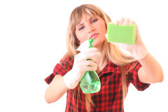 Young woman with cleaning supplies isolated Royalty Free Stock Photography