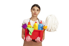 Young woman with cleaning supplies on white background Royalty Free Stock Photo