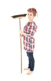 Young woman with cleaning sweep, full length Royalty Free Stock Photography