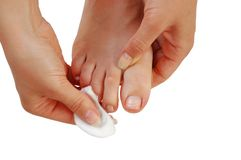 Young Woman Cleaning Toenails Royalty Free Stock Image