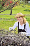 Young woman cleaning tree limbs Stock Photo