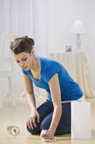 Young Woman Cleaning Water Spill Royalty Free Stock Photos