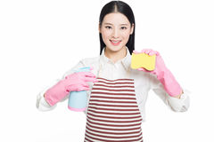 Young woman cleaning on white stock photos