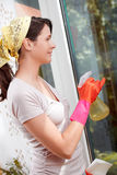 Young woman cleaning a window Stock Images