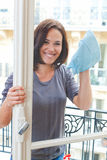 Young woman cleaning windowpane Royalty Free Stock Images